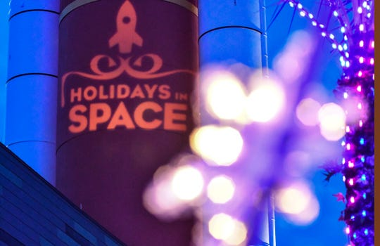 Friday night was the kick off for the Kennedy Space Center Visitor Complex Holidays in Space, a 1960s retro holiday bash with 10,000 sparkling lights, period music and decor. The logo was projected on the scale hi-fi model of the orbiter fuel tank.
