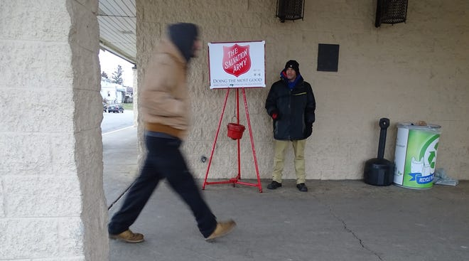 Bobby Hall rings the bell at a Salvation Army kettle outside the Bucyrus Kroger store earlier this week. This Saturday and next, members of local Kiwanis and Rotary clubs will take over the bell-ringing duties.