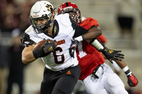 Refugio's Ysidro Mascorro runs the ball during the first quarter of the 2A Division I state semifinal against San Augustine at Cy-Fair FCU Stadium in Cypress on Thursday, Dec. 12, 2019.