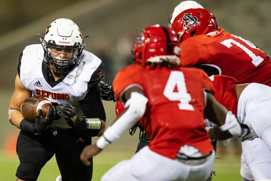 Refugio's Ysidro Mascorro runs the ball during the third quarter of the 2A Division I state semifinal against San Augustine at the Cy-Fair FCU Stadium in Cypress on Thursday, Dec. 12, 2019.