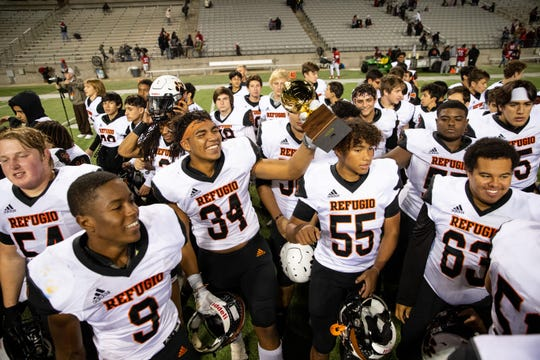 Refugio players celebrate defeating San Augustine 29-21 in the 2A Division I state semifinal at the Cy-Fair FCU Stadium in Cypress on Thursday, Dec. 12, 2019.