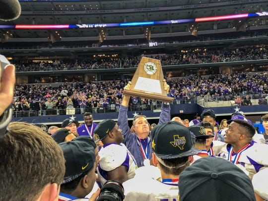 Johnston lifts the 2018 Texas 3A division II state title for the second year in a row.