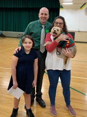 Auditor Tom Spetnagel Jr. presented fourth grade student Livi McKee the award for her essay about her dog Mack. Also pictured is Stephanie McKee, Livi's mother.