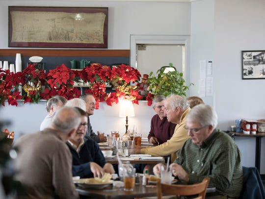 Patrons eat at Sky Galley Restaurant in the Lunken Airport Terminal on Friday, Dec. 13, 2019, in East End.