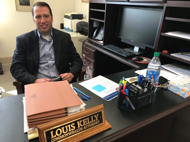 Boone County Commonwealth's Attorney Louis Kelly works at a desk in a Burlington office that's near the county's courthouse.
