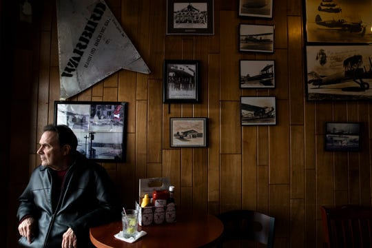 Denny Peter stares out the window at the airstrip at of Lunken Airport while dining at Sky Galley in East End on Friday, Dec. 13, 2019. Peter said he has been eating at Sky Galley for 20 years and brings his grandchildren to watch the planes from the restaurant.