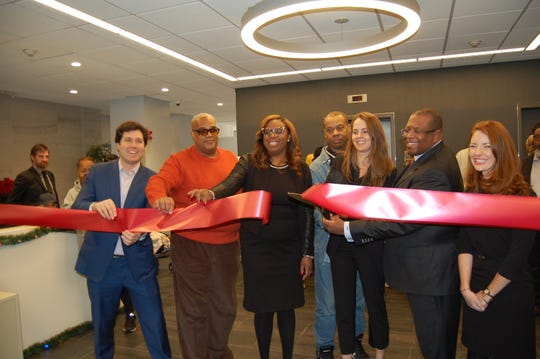 From left, BRP Companies, Newark City Council Member LaMonica McIver, residents, St. James A.M.E. Development Corporation and NJHMFA Chief of Staff Katherine Brennan, right, celebrate the ribbon cutting at 440 Washington Street.
