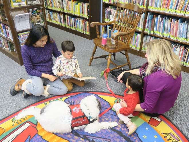 Pictured are Angela Fu, Tyler Colotti, 4, Verona Colotti, 3, of the Basking Ridge section of Bernards, with Zoe the Therapy Dog and her owner Valerie Pena, of the Colonia section of Woodbridge.