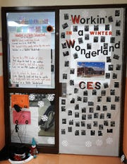 "The first grade classroom of Lana Lawson won the originality award for the second annual door decorating contest at Coshocton Elementary School. The song ""Workin' in a Winter Wonderland"" with lyrics relating to the PAX Leadership program at the school was recorded and played outside the room as judges passed."