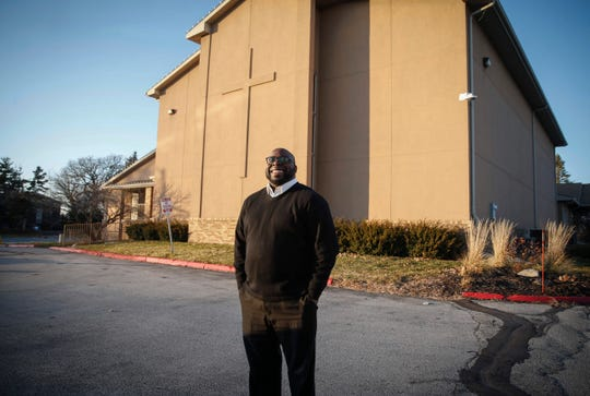 The Rev. Rob Johnson poses for a photo outside of Corinthian Baptist Church on School Street in Des Moines on Dec. 6.