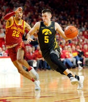 Iowa guard CJ Fredrick drives to the basket as the Hawkeyes take on the Cyclones at Hilton Coliseum in Ames Thursday, Dec. 12, 2019.
