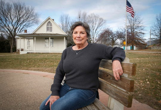 Donna Jeffrey, a lifelong resident of Eldon, a small community of about 900 people in southeast Iowa, helped create an educational center at the American Gothic visitor center, which draws about 15,000-20,000 people annually. The American Gothic house (in background) was made famous by a painting by artist Grant Wood in 1930.
