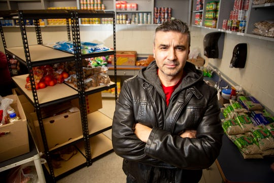 Rev. Al Perez stands for a portrait in the food pantry at King Elementary Friday, Dec. 13, 2019.