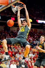 Iowa center Luka Garza dunks the ball as the Hawkeyes take on the Cyclones at Hilton Coliseum in Ames Thursday, Dec. 12, 2019.