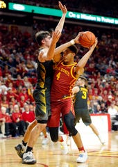 Iowa State forward George Conditt IV drives to the basket as the Hawkeyes take on the Cyclones at Hilton Coliseum in Ames Thursday, Dec. 12, 2019.