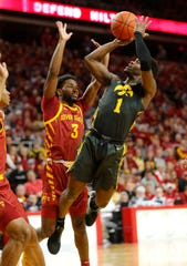 Iowa guard Joe Toussaint puts up a shot as the Hawkeyes take on the Cyclones at Hilton Coliseum in Ames Thursday, Dec. 12, 2019.