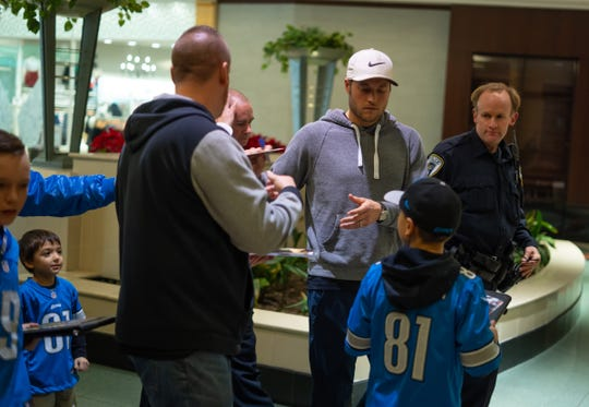 Detroit Lions Quarterback Matt Stafford signs autographs for fans while being escorted out by security after taking part in Mitch Albom's Say Detroit Radiothon at Somerset Collection in Troy on Thursday, December 12, 2019.