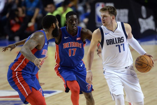 Luka Doncic dribbles vs. Pistons forward Tony Snell (17) and center Andre Drummond during the second half Thursday in Mexico City.