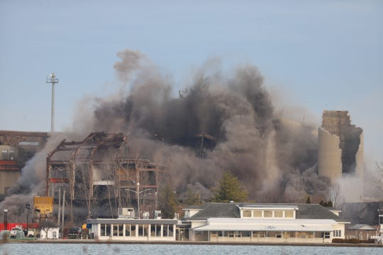 DTE Energy blasts the remains of its Conners Creek power plant Friday, Dec. 12 2019, as part of the land assembly needed for Fiat Chrysler Automobiles' new Jeep plant project on the east side.