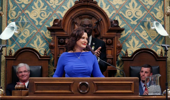 In this Feb. 12, 2019 file photo, Michigan Gov. Gretchen Whitmer delivers her State of the State address to a joint session of the House and Senate as Senate Majority Leader Mike Shirkey, House Speaker Lee Chatfield, right, and Lt. Gov. Garlin Gilchrist, rear, react, at the state Capitol in Lansing, Mich.