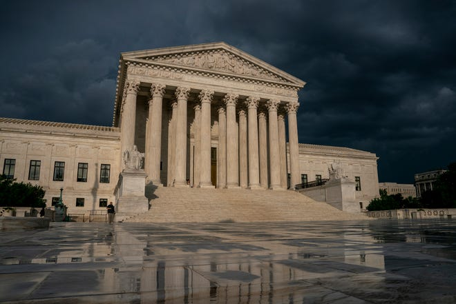FILE - In this June 20, 2019 file photo, The Supreme Court is seen under stormy skies in Washington.