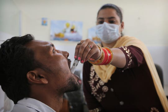In this Thursday, Oct. 31, 2019, photo, a medic administers medicine to a recovering drug user at a de-addiction center in Kapurthala, in the northern Indian state of Punjab.