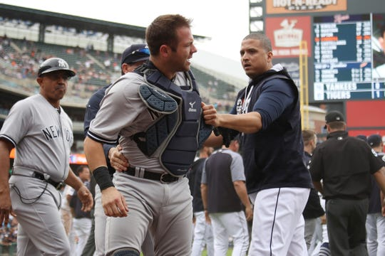 Austin Romine is held back by Victor Martinez during a brawl in 2017.