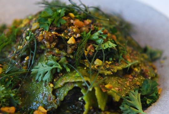 Mandilli consisting of Bagna càuda sauce, pistachios and spinach pasta.