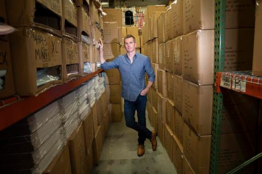 Tim Murphy, president of Softies, poses for a photo in the stacked boxes of the company's Edina warehouse, boxes that will all be sent in the next week after making Oprah's Favorite Things list three years in a row, on Wednesday, Nov. 20, 2019. (Renee Jones Schneider/Minneapolis Star Tribune/TNS)