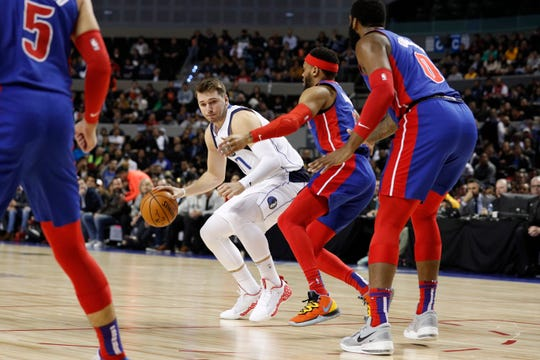 The Mavericks' Luka Doncic dribbles the ball against Pistons in the first half.