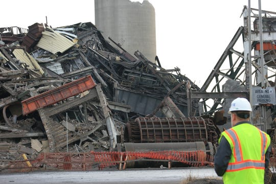 DTE Energy's old Conners Creek Power Plant was demolished Friday between Jefferson Avenue and the Detroit River to make room for Fiat Chrysler Automobiles NV's $2.5 billion plant expansion project on Detroit's east side.