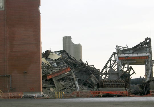 DTE Energy Co.'s old Conners Creek Power Plant was demolished Friday between Jefferson Avenue and the Detroit River to make room for Fiat Chrysler Automobiles NV's $2.5 billion plant expansion project on Detroit's east side. One wall still stood as protection from the implosion.