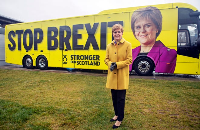 Scottish National Party (SNP) leader Nicola Sturgeon launches the party's election campaign bus, featuring a portrait of herself, at Port Edgar Marina in the town of South Queensferry, Scotland, before setting off on a tour of Scotland for the final week of the SNP's General Election campaign, Thursday Dec. 5, 2019.