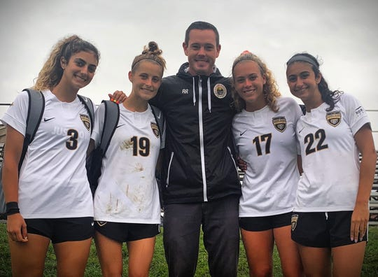 Detroit Sun coach Aaron Roy is joined by Sun team members who play for Oakland University Fotini Demetriou, left to right, Nikki May, Coach Aaron Roy, Sierra Grodsinsky and Alexa Sabbagh.