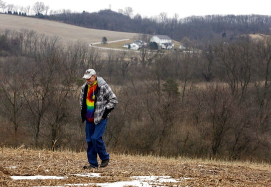 In this Saturday, Feb. 23, 2019 photo, Mike Carpenter, uncle of Greg Longenecker, walks the field where Longenecker was killed by a bulldozer in 2018, in Bernville, Pa. A federal lawsuit accuses Pennsylvania State Police of gross recklessness for using a bulldozer to chase and inadvertently run over and kill Longenecker, who had fled after being caught growing marijuana on public land.
