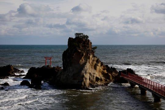 A torii gate stands on a small island in Iwaki, Fukushima prefecture, Japan.