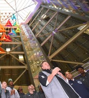 Oakland's Greg Kampe speaks at a pep rally Friday in Detroit.