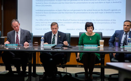 The Michigan State University Board of Trustees holds a meeting for the first time since the appointment of Renee Knake to replace resigned trustee Nancy Schlichting on Friday, Dec. 13, 2019. From left are Vice Chair Dan Kelly, President Samuel L. Stanley, Trustee Dianne Byrum and Trustee Brian Mosallam.