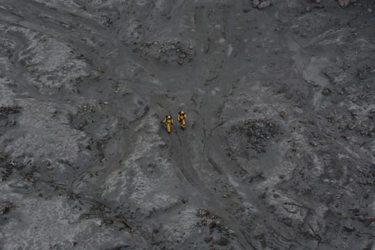 This photo released by the New Zealand Defense Force shows an operation to recover bodies from White Island after a volcanic eruption in Whakatane, New Zealand, Friday, Dec. 13, 2019. A team of eight New Zealand military specialists landed on White Island early Friday to retrieve the bodies of victims after the Dec. 9 eruption.