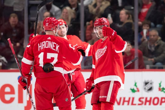 Detroit right wing Filip Zadina, right, celebrates with his teammates after scoring a goal in the second period.