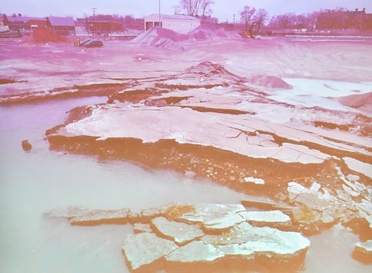 A photo of  the aftermath of the dock collapse is shown at the meeting Thursday at Cass Corridor Commons in Detroit.