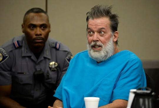 In this Dec. 9, 2015 file photo, Robert Lewis Dear talks to Judge Gilbert Martinez during a court appearance in Colorado Springs, Colo.