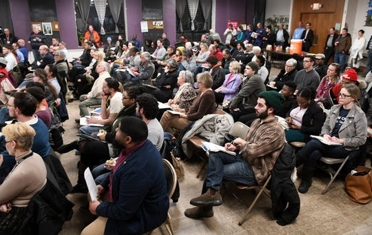 Community members gather in Detroit on Thursday for a meeting in response to a dock collapse that sent piles of aggregate stored by Detroit Bulk Storage into the Detroit River last month.