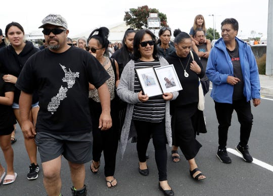Families of victims of the White Island eruption walk to a nearby marae after arriving back to the Whakatane wharf following a blessing at sea ahead of the recovery operation off the coast of Whakatane New Zealand, Friday.