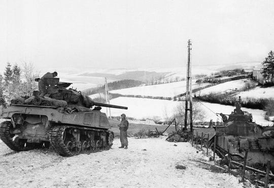 In this Jan. 6, 1945 file photo, American tanks wait on the snowy slopes in Bastogne,Belgium.