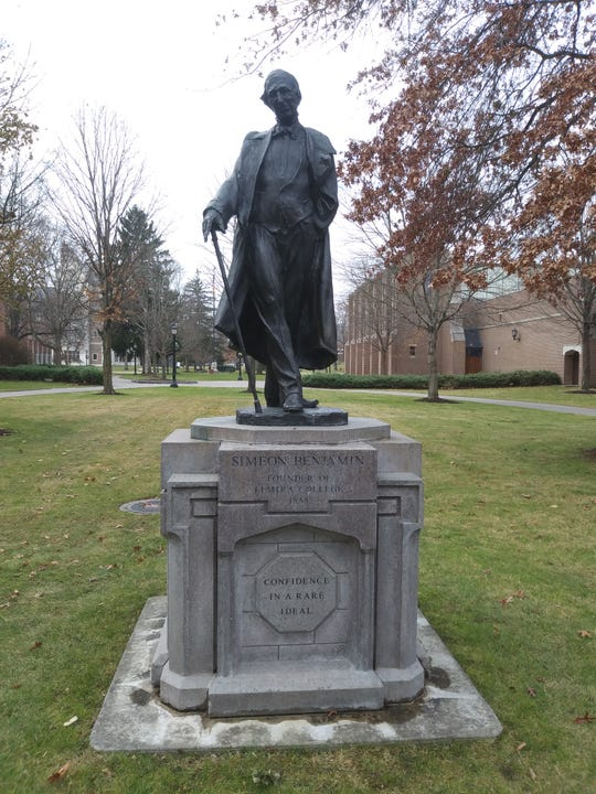 A statue of Elmira College founder Simeon Benjamin on the college's campus.
