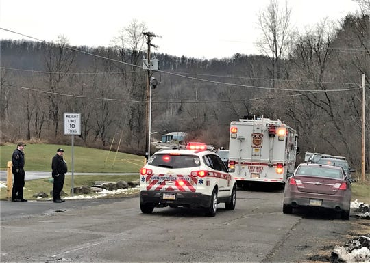 Emergency vehicles drive up to the scene of a standoff and shooting incident Dec. 10 on Barney Hill Road in Nelson Township, Tioga County.