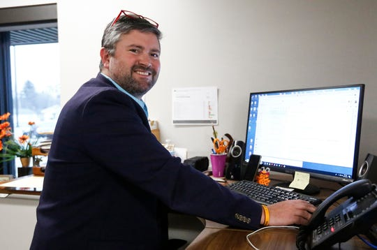 North Fond du Lac School's District Administrator Aaron Sadoff works at his desk Friday, Dec. 13, 2019, in his office at Friendship Learning Center in North Fond du Lac, Wis.