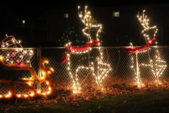 Motorists got to see dozens of Christmas light displays like this one featuring Santa and his reindeers Thursday at the Sandusky County Fairgrounds annual Winter Wonderland.