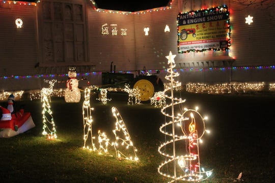 The Sandusky County Fairgrounds' Winter Wonderland opened Thursday night. Motorists could drive through the fairgrounds and look at dozens of lighted Christmas displays put up by local businesses and community groups.